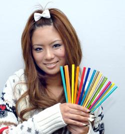Hip young Japanese businesswoman Shiho Fujita proudly shows off her collection of my-hashi chopsticks.