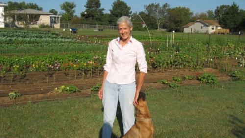 Nancy Dockter in front of her garden, Sun Harvest.