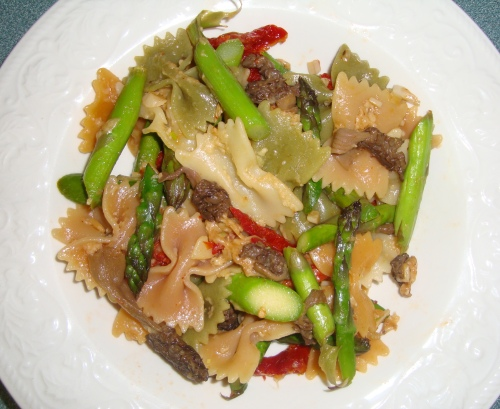 We cooked bow-tie pasta with morels, asparagus and sun-dried tomatoes. YUM!