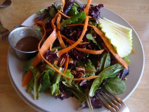 Greenhouse Salad made with organic greens, carrot ribbons, green apples, dried cranberries and toasted pecans with balsamic vinaigrette.