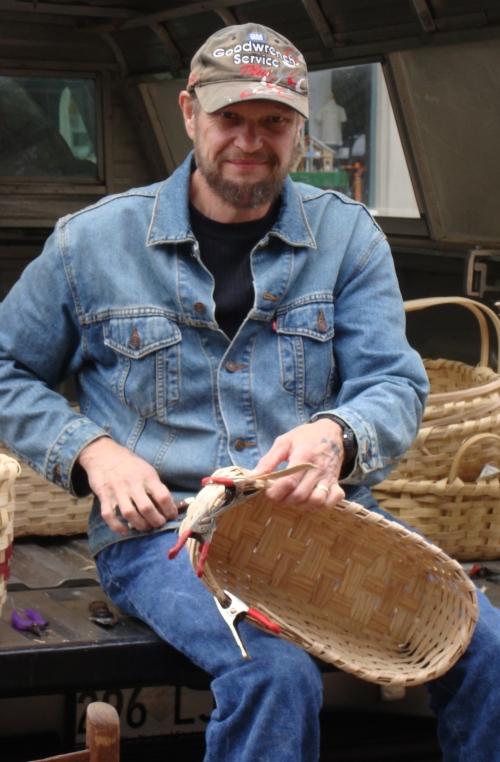 A basket weaver weaves a basket.