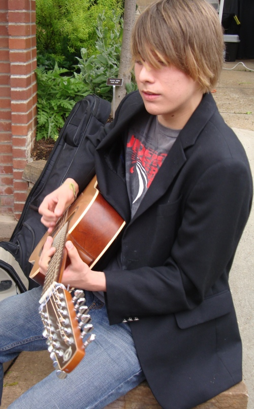 A young musician plays his guitar. He was GOOD!