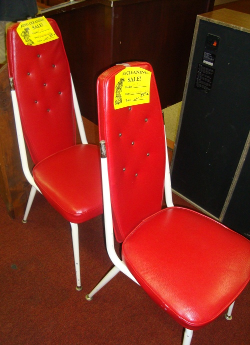 Retro red chairs for $20 each.