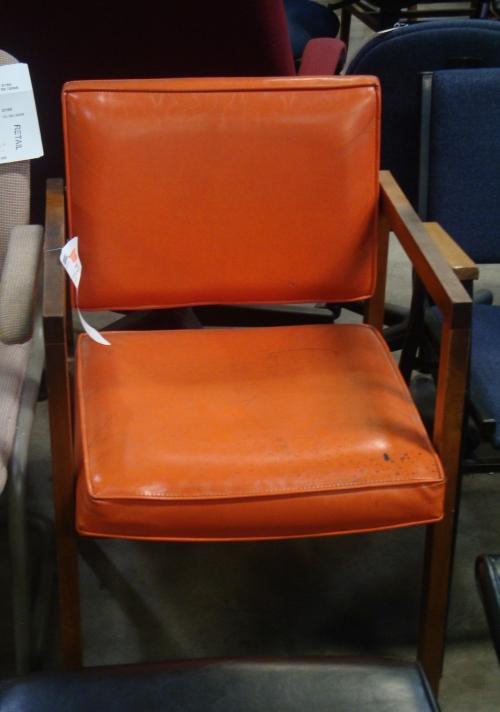 A very cute orange chair.