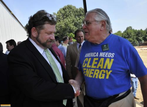 Bill Saunders, a Sierra Club member, shakes hands with Sam Anderson, CEO, Phoenix Renewable Energy.