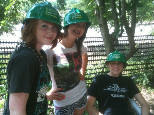 Area high school students model green hard hats.